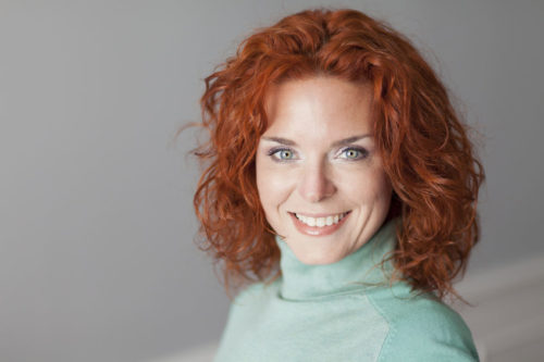 how to wear colour, woman with red hair and blue eyes, warm dominant