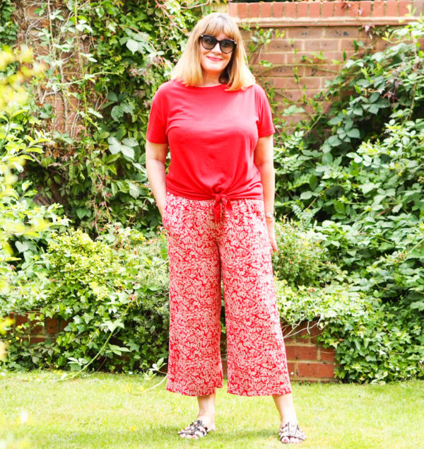red print trousers with long red tunic top