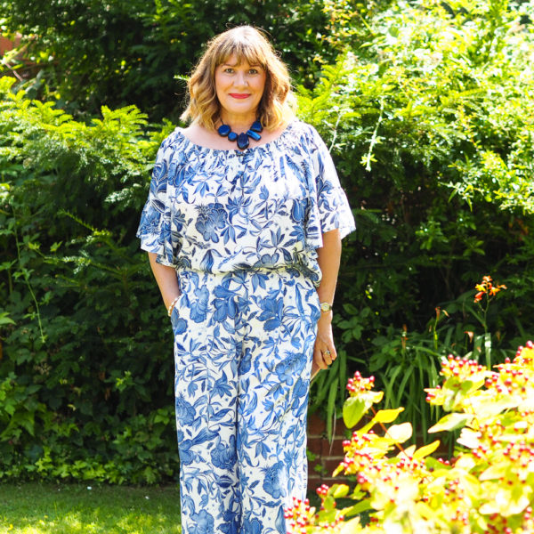 Blue print trousers and matching bardot top, blue statement necklace