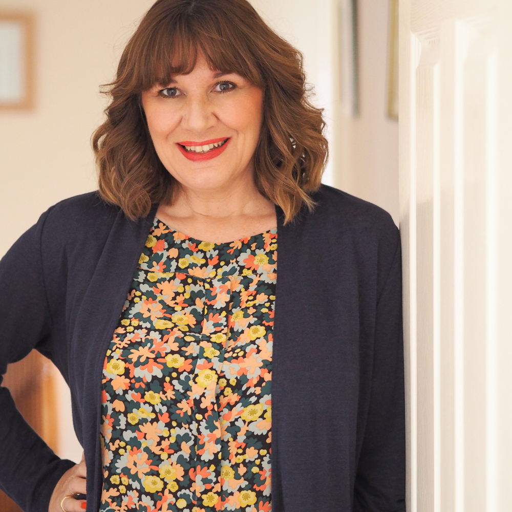 Maria Sadler stylist and fashion blogger, floral top and navy linen cardigan, create a wardrobe you love