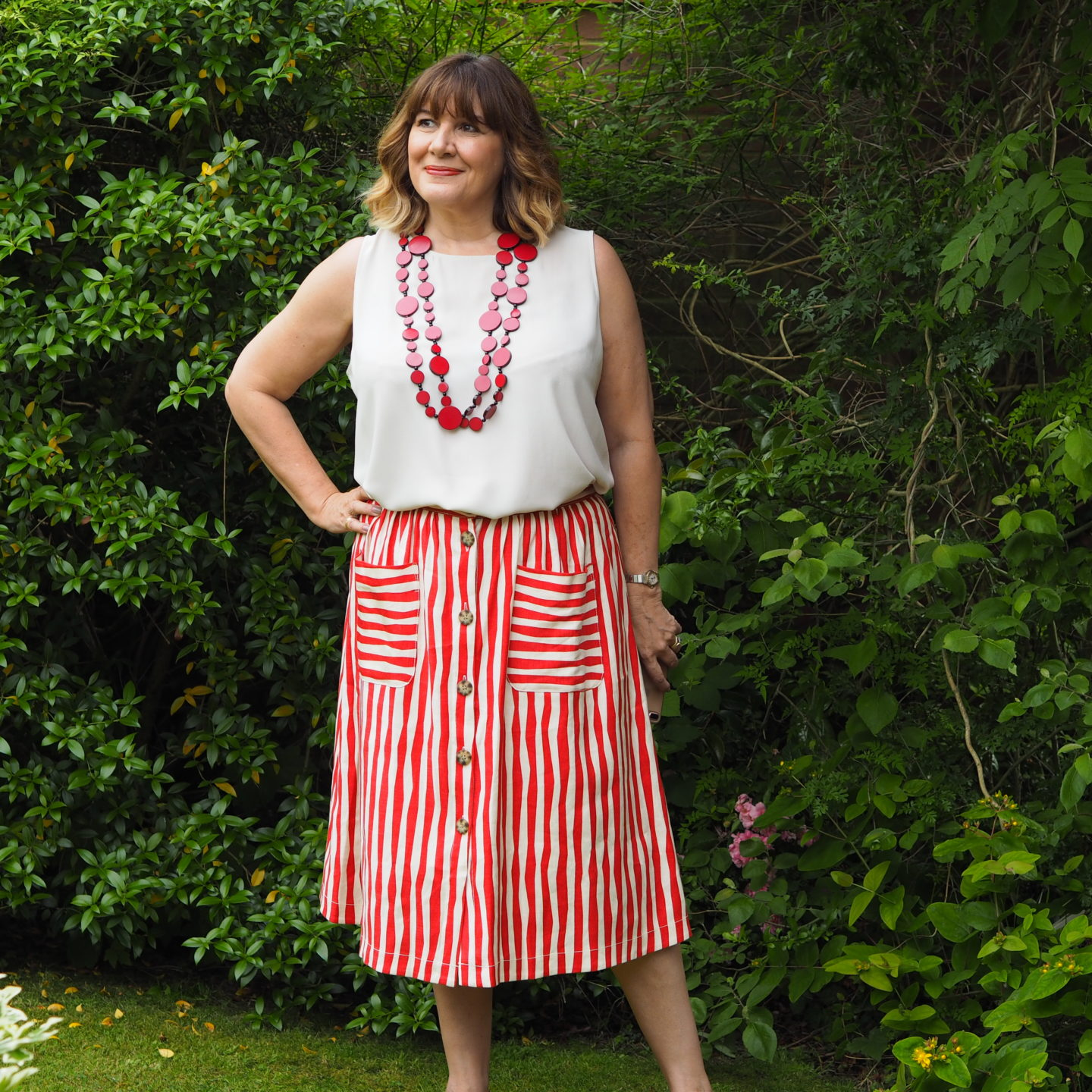 aria Sadler stylist fashion blogger wearing LK Bennett multi tasking linen red stripe skirt