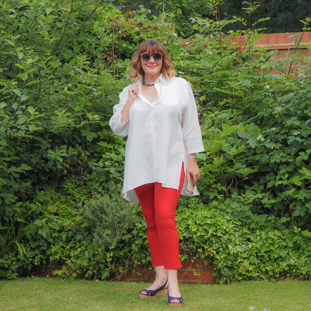 aria Sadler stylist fashion blogger wearing Weekend Maxmara multi tasking linen white shirt Eileen Fisher red trousers