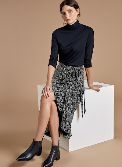 High/Low styling trick, Buakjen spot ruffle skirt, polo neck sweater and Chelsea boots