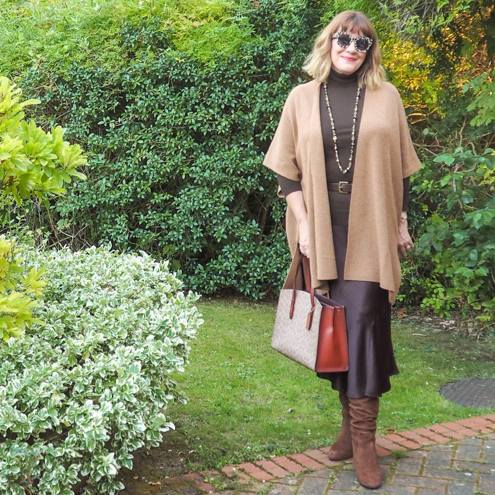 High/Low styling trick, Maria Sadler stylist, brown Mint Velvet satin skirt, brown polo neck, Camel cardigan, Coach tote and boots