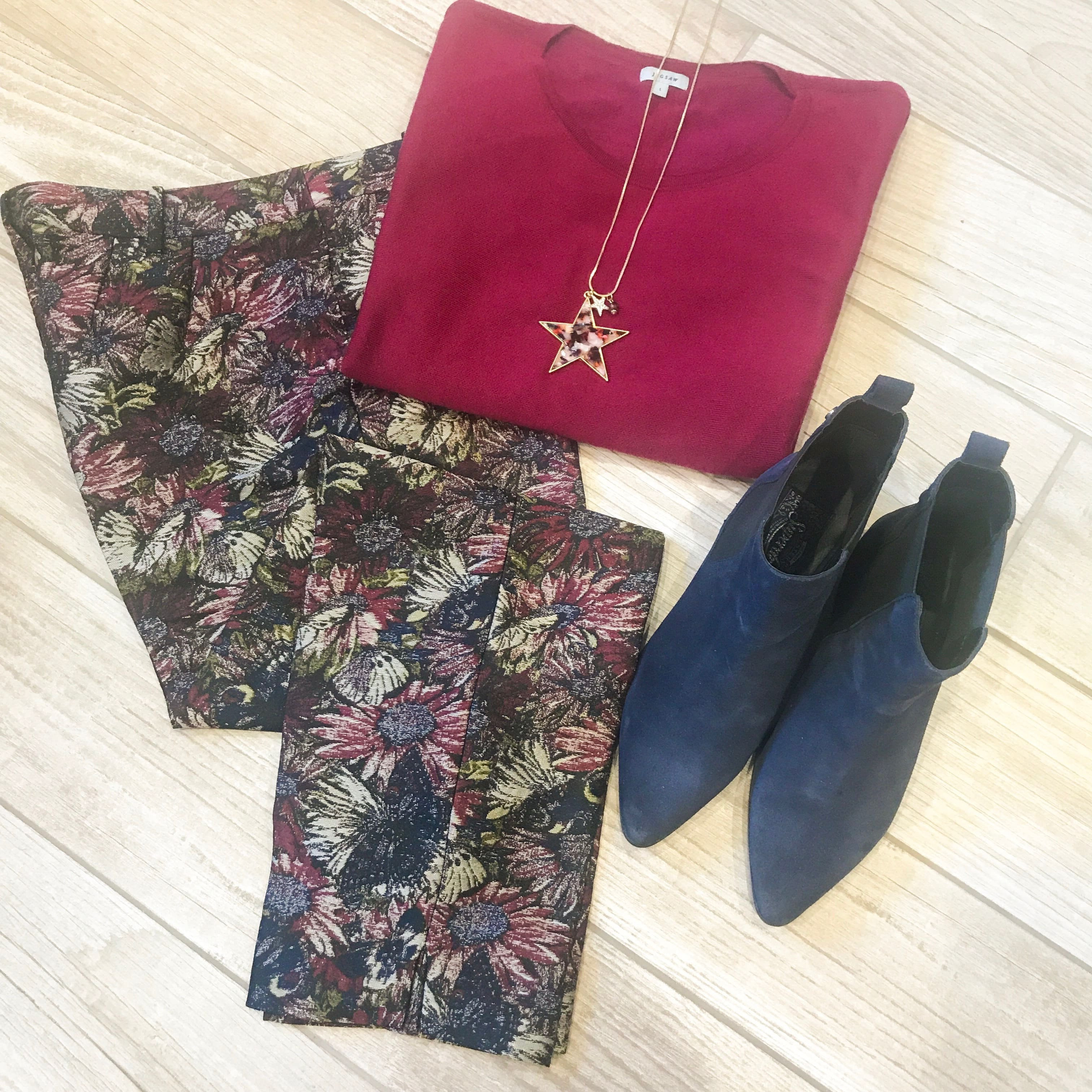 High/Low styling trick, floral trousers, burgundy knit top, star pendant, navy Chelsea boots