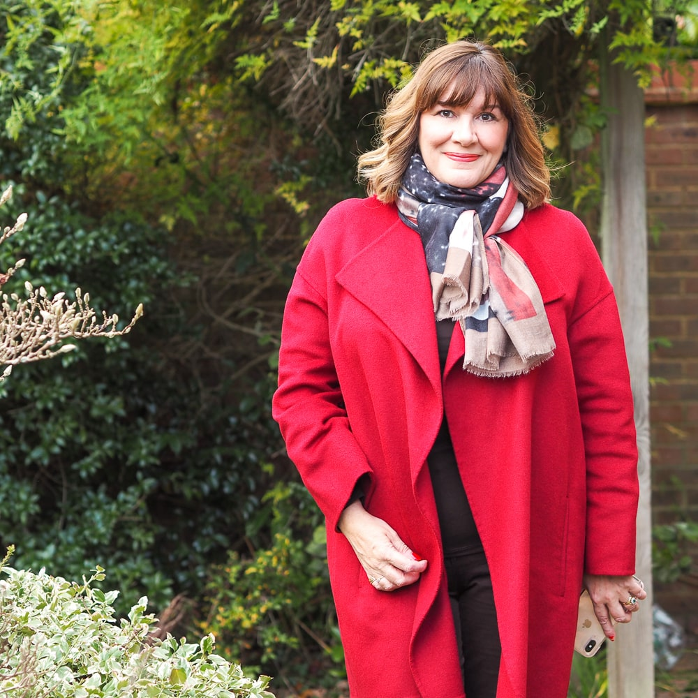 the coats you need in your winter wardrobe, Maria sale stylist wearing red coat, capsule accessories print scarf