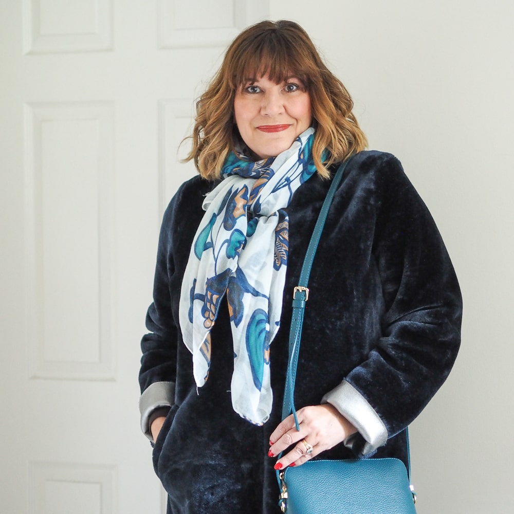 the coats you need in your winter wardrobe, Maria sale stylist wearing faux fur coat, capsule accessories teal bag, print scarf