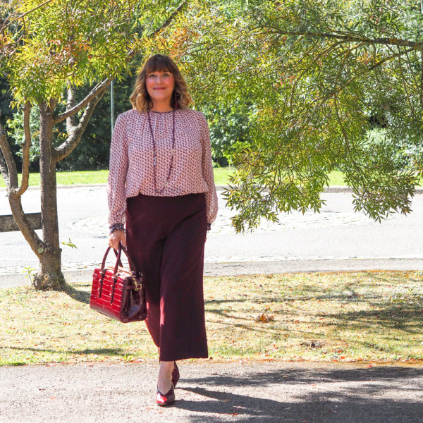 Maria Sadler, stylist and fashion blogger wearing Whistles burgundy culottes, Aspinal bag, Boden top
