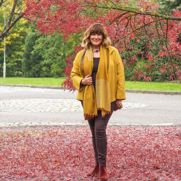 Maria Sadler, Stylist and Fashion blogger, wearing yellow jacket, brown jeans, Eileen Fisher scarf