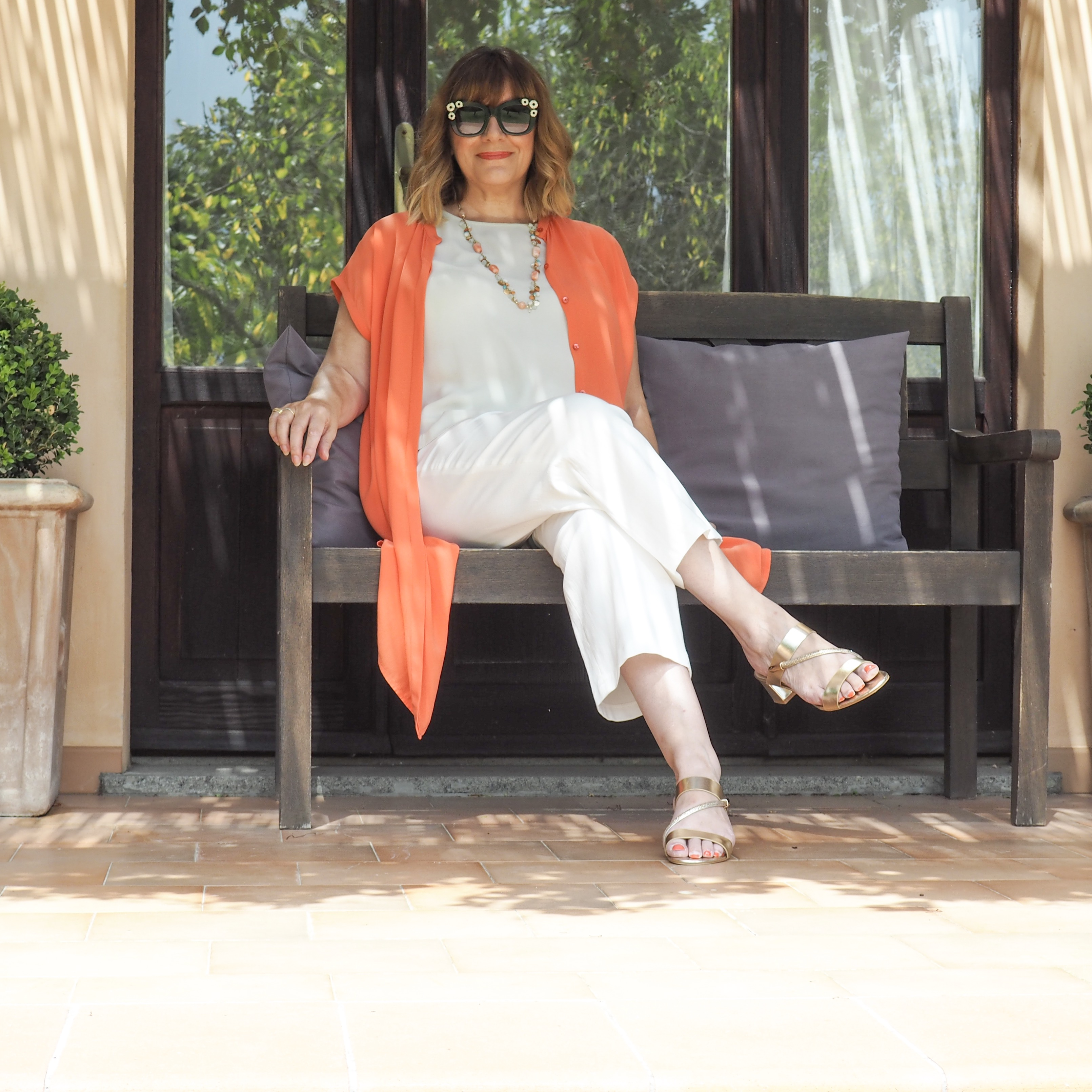 How to discover your personal style, maria sadler, stylist and fashion blogger, Eileen Fisher orange silk dress, Ivory trousers