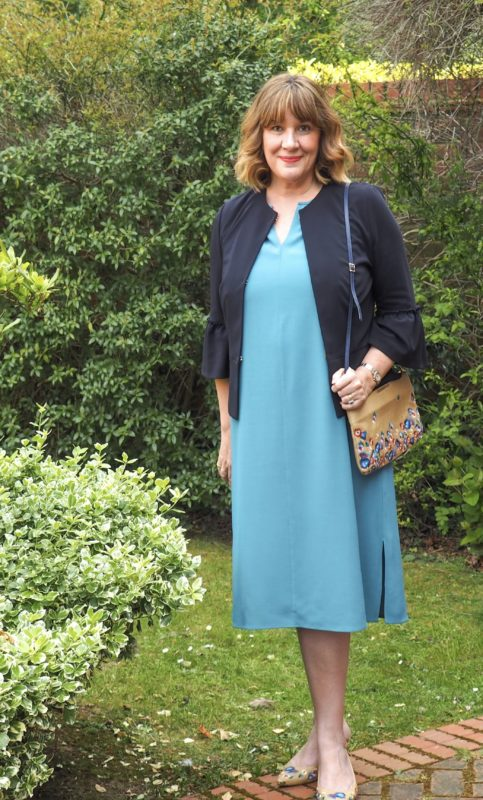 what to wear with a teal dress, Maria Sadler stylist and fashion blogger, teal Eileen Fisher dress, Navy jacket