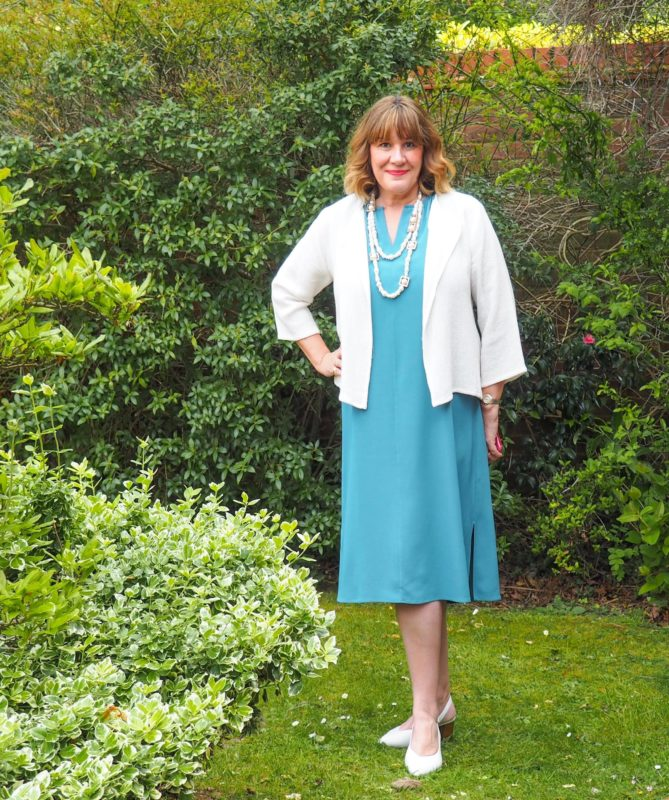 what to wear with a teal dress, Maria Sadler stylist and fashion blogger, teal Eileen Fisher dress, white jacket