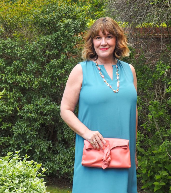 what to wear with a teal dress, Maria Sadler stylist and fashion blogger, teal Eileen Fisher dress, peach bag and shoes