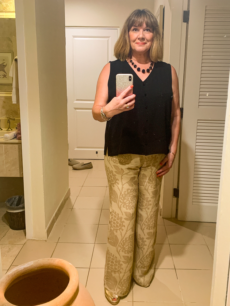 beach holiday capsule wardrobe, Maria Sadler, stylist and fashion blogger wearing palazzo trousers and black silk top at Curtain Bluff Antigua