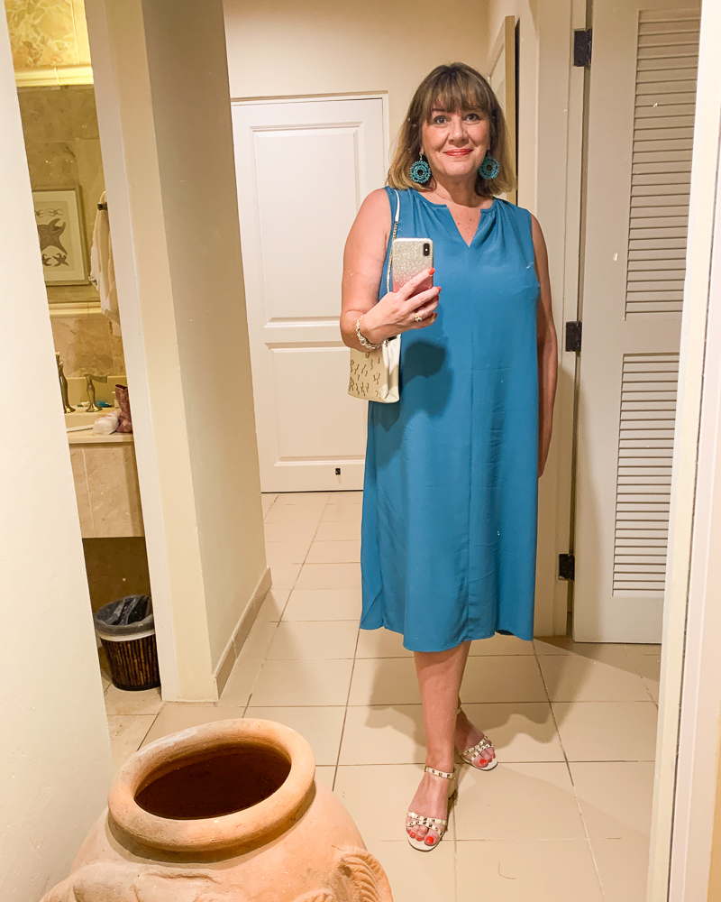 beach holiday capsule wardrobe, Maria Sadler, stylist and fashion blogger wearing teal Eileen Fisher dress at Curtain Bluff Antigua