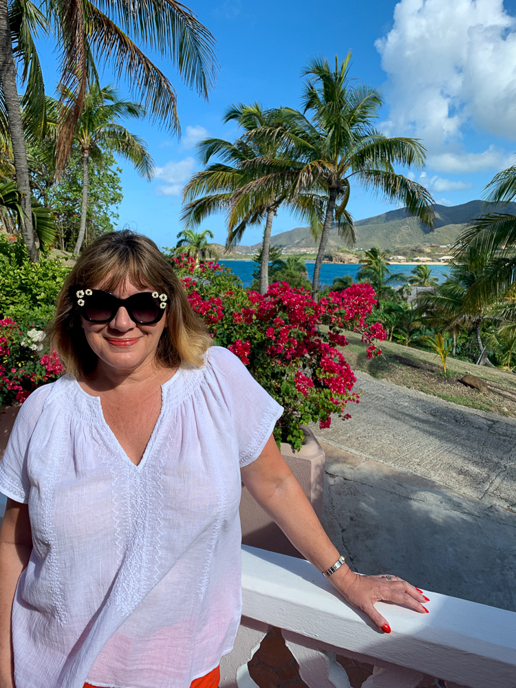 beach holiday capsule wardrobe, Maria Sadler, stylist and fashion blogger wearing white top at Curtain Bluff Antigua