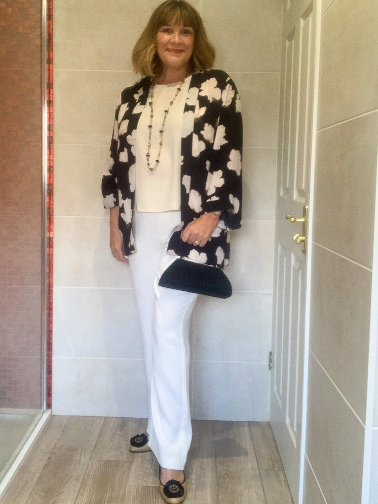 How to Wear a Kimono Jacket 3 ways, with a pair of cream wide leg trousers, camisole and black accessories