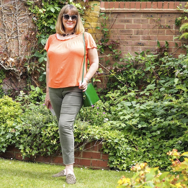 best jeans for women over 40, green cropped jeans, orange top,