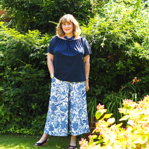 How to wear wide leg trousers, blue print trousers with navy bardot top, wedge sandals